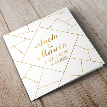 Zaproszenia ślubne geometryczne z złotymi elementami.